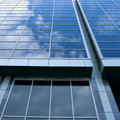Beautiful clouds reflecting in  wall of skyscraper Royalty Free Stock Image