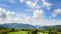 Beautiful clouds and sky above the green mountain nature landscape of range at mae hong son province northern thailand widescreen Stock Photo