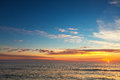 Beautiful cloudscape with flying birds over the sea, sunrise shot Royalty Free Stock Photo