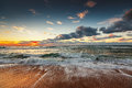 Beautiful cloudscape over the sea. Ocean Waves crashing onto the shore. Royalty Free Stock Photo