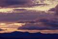Beautiful cloudy sky at sunset and mountains silhouette Royalty Free Stock Images