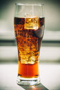 Beautiful cold fizzy cola soda with cubes ice