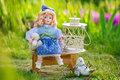 Beautiful collectible doll in the garden bloom still life spring with vintage Royalty Free Stock Photography