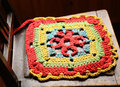 Beautiful colored hand made knitted serviette for chair seat Stock Photography
