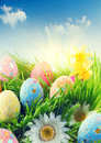 Beautiful colorful eggs in spring grass