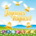 Beautiful and colorful French Happy Easter greeting card I with easter eggs and bells. Royalty Free Stock Photo