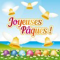 Beautiful and colorful French Happy Easter greeting card III with easter eggs and bells. Royalty Free Stock Photo