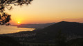 Beautiful colorful golden sunset over the black sea bay beside the mountains. Tuapse, Russia. Royalty Free Stock Photo