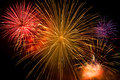 Beautiful colorful holiday fireworks on the black sky