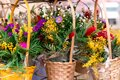 Beautiful colorful spring flowers in a wicker yellow baskets. Copy space for greeting postcard