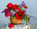 Beautiful composition of flowers in basket in vintage style Royalty Free Stock Photo