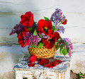 Beautiful composition of flowers in basket in vintage style Stock Photography