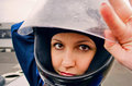Beautiful confidence girl in racing helmet close up Stock Photos