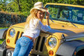 Beautiful Country Girl posing on a vehicle Royalty Free Stock Photo