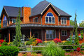 Beautiful country home a large redwood a wide open porch and decking full landscaping with rustic rail fence Stock Photos