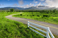 Beautiful countryside road in green field under blue sky chiang mai thailand Royalty Free Stock Images