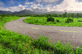 Beautiful countryside road in green field under blue sky chiang mai thailand Stock Image