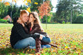 Beautiful couple in autumn park Stock Photo