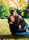 Beautiful couple in autumn park Stock Photos