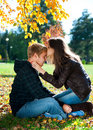 Beautiful couple in autumn park Stock Images
