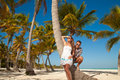 Beautiful couple on beach on vacation travel happy young romantic in love have fun and relaxing caribbean Stock Image