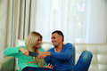 Beautiful couple bickering to change tv channel Royalty Free Stock Photo