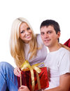 Beautiful couple with a gift Stock Images