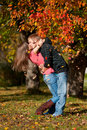 Beautiful couple kissing in autumn park Royalty Free Stock Photography