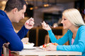 Beautiful couple on lunch looking at each other Royalty Free Stock Images