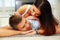 Beautiful couple relaxing on the floor young at home Stock Photo
