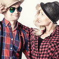 Beautiful couple smiling blonde young women posing with handsome men wearing hat Stock Image