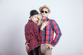 Beautiful couple smiling blonde young women posing with handsome men wearing hat Stock Photo
