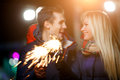 stock image of  Beautiful couple with sparklers outdoors