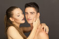 Beautiful couple in studio portrait girl tenderly men posing to the camera Stock Images