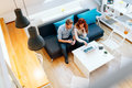 Beautiful couple working in a cosy living room Royalty Free Stock Photo
