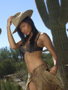 Beautiful Cowgirl In Front of Cactus Stock Photo