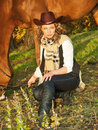 Beautiful  cowgirl with her red horse Stock Photography