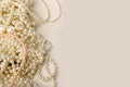 Beautiful cream wedding pearl necklaces on a grey background Royalty Free Stock Photo