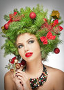 Beautiful creative Xmas makeup and hair style indoor shoot. Beauty Fashion Model Girl. Winter. Beautiful fashionable in studio Royalty Free Stock Photo