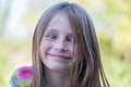 Beautiful cross-eyed young girl outdoors, portrait children close up Royalty Free Stock Photo