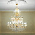 Beautiful crystal chandelier ancient in a hall lamp with soft yellow light Stock Images