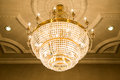 Beautiful crystal chandelier in ball room Royalty Free Stock Photo