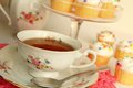 Beautiful cup tea little cakes background Royalty Free Stock Photos