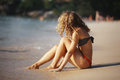 Beautiful curly girl rest on  beach Royalty Free Stock Photo