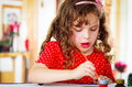 Beautiful curly little girl painting Royalty Free Stock Photo