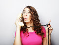Beautiful curly woman  talking on white vintage telephone Royalty Free Stock Photo