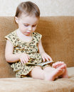 Beautiful cute baby reading book sitting couch Royalty Free Stock Photography