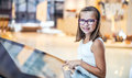Beautiful cute little girl studying orientation plan in shopping mall. Shopping Center Store Guide. Modern touch screen technology Royalty Free Stock Photo