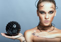 Beautiful cyber girl with black prickly ball Royalty Free Stock Image