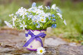 Beautiful daisy flowers in small decorative vase Royalty Free Stock Photo